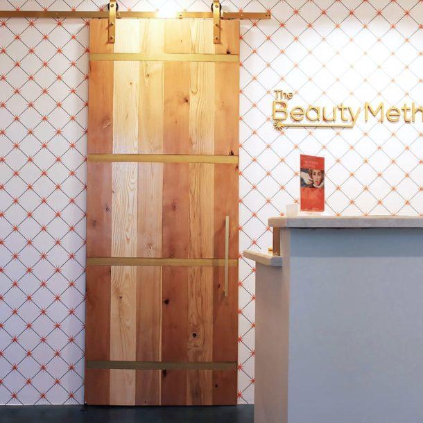 (Cover Photo) Front Desk Barn Door The Beauty Method